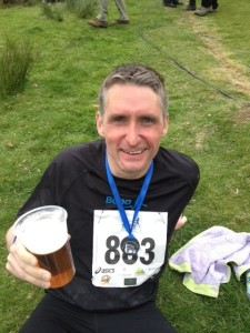 Adam enjoys a well-deserved beer!