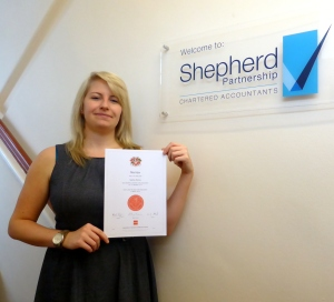 Sophie with her official qualification certificate